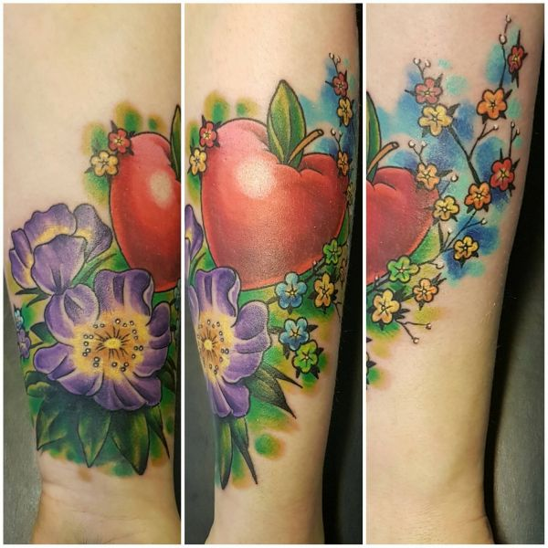 this is a coverup; I'll try and get a pic of what we covered up. but ye, put a heart apple and flowers wrapping from the wrist. tattoo fixers ain't got shit on me: Swipe To View More Images